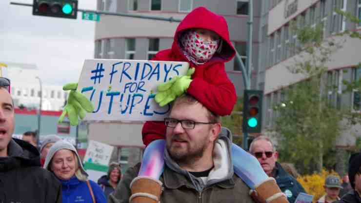 A young protester holds up a Fridays For Futures sign in Yellowknife