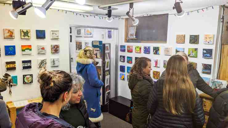 Yellowknife residents admire anonymous works of art inside the Down to Earth Gallery