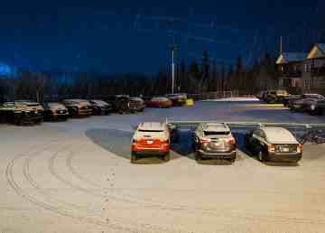 Snow falls on vehicles in a Yellowknife parking lot early on the morning of November 4, 2019