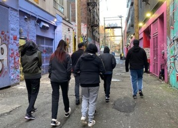 An RCMP handout photo of Whatì youth on Vancouver's streets during addictions awareness training