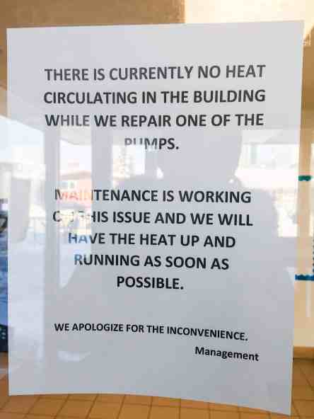 A notice inside Aurora College apologizes for a lack of heat in the building