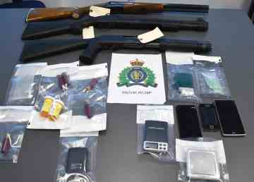 An Inuvik RCMP handout photo of weapons and drug paraphernalia reportedly seized in February 2020.
