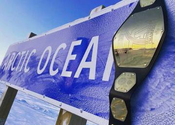 A photo supplied by Totally Arctic Wrestling shows a belt atop an Arctic Ocean sign