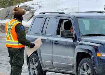 A public health officer talks to a driver at a pandemic checkstop in Yellowknife on April 18, 2020