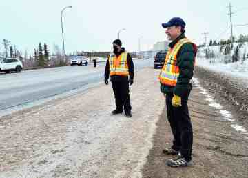 Adrien Barrieau, left, and Conrad Baetz, deputy chief public health officers, conduct a pandemic enforcement checkstop in Yellowknife in April 2020