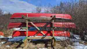 A file photo of red canoes at the Back Bay dock in Yellowknife in May 2020. Sarah Pruys/Cabin Radio