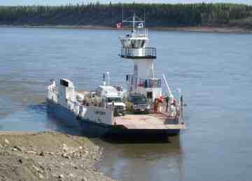 MV Lafferty transports vehicles across the Liard River crossing in a territorial government photo