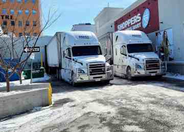 Supply trucks parked outside a Yellowknife grocery store in April 2020