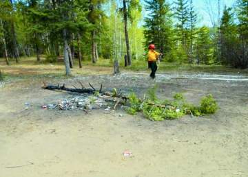 A firefighter at the scene of an abandoned campfire in Fort Smith is pictured in a Department of Environment and Natural Resources photo