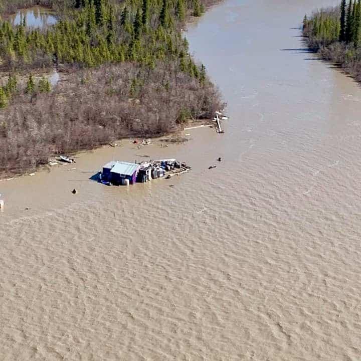 An aerial photo taken around 6 p.m. Sunday shows the waters of the Mackenzie near Kalinek point flooding Jimmy Kalinek's cabin