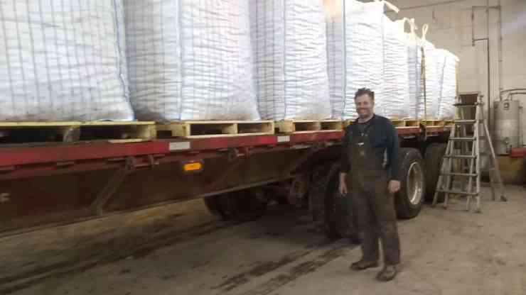 A Sunnycrest Farms worker stands in front of the truck loaded with 50,000 pounds of potatoes in this photo submitted by Jackie Milne