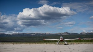 A Department of Environment and Natural Resources Fire Boss aircraft sits at the Norman Wells airport in June 2020
