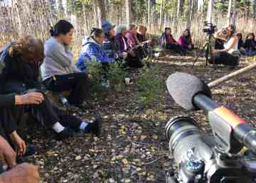 Elders, youth, fluent language speakers and staff members share teachings out on the land