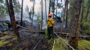 A photo of an NWT firefighter actioning a fire. Photo: NWT Fire