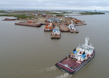 An NWT government photo of barges in Tuktoyaktuk harbour