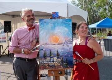 Terry Pamplin and Jen Walden with a work of art produced during the 47 Street Festival