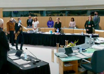 Katrina Nokleby, front right, stands with other MLAs as an emergency sitting at the NWT legislature begins on August 24, 2020