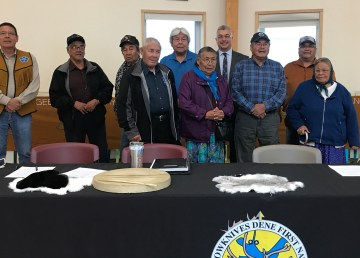 Chief Ernest Betsina, MP Micheal McLeod, and Chief Edward Sangris with Yellowknives Dene Elders at Friday's signing