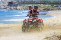 Discount ATV Adventure tours churning up sand on the beach Wild Canyon, Cabo San Lucas, Los Cabos