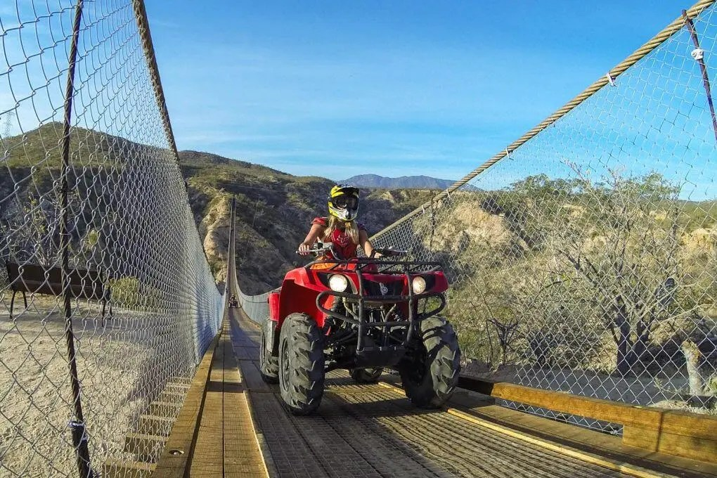 ATV-crossing-bridge-wild-canyon