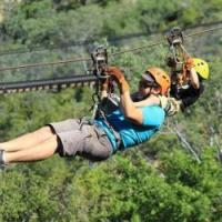 Kid zip lining with dad wild canyon cabo activities for kids in cabo