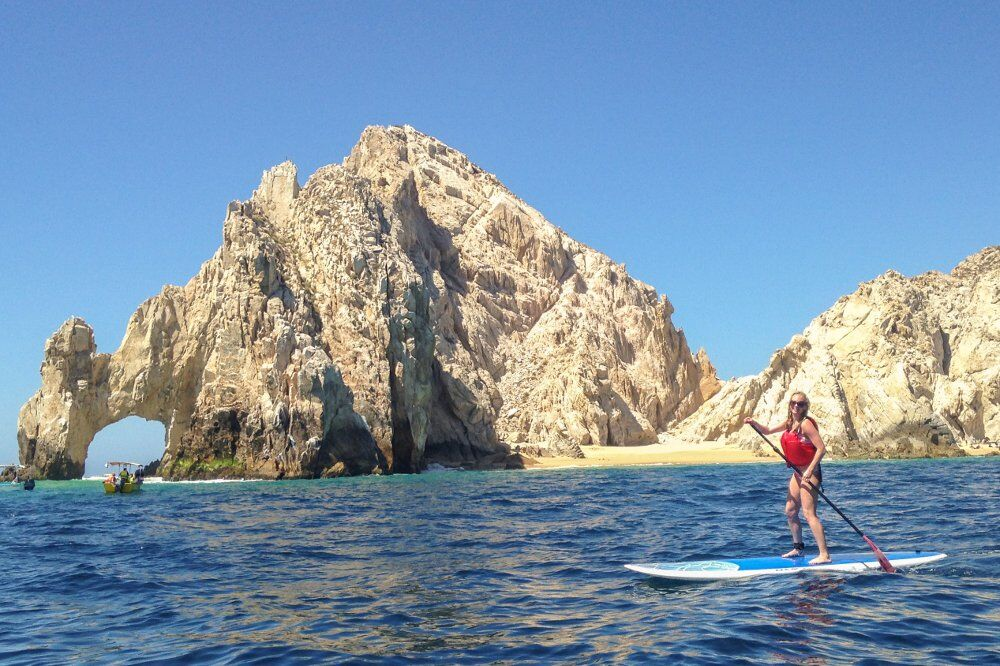 SUP stand up paddle boarding in the Cabo San Lucas bay near the arch