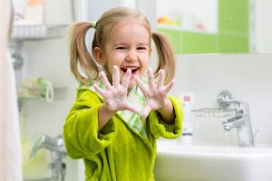 Little girl showing hands