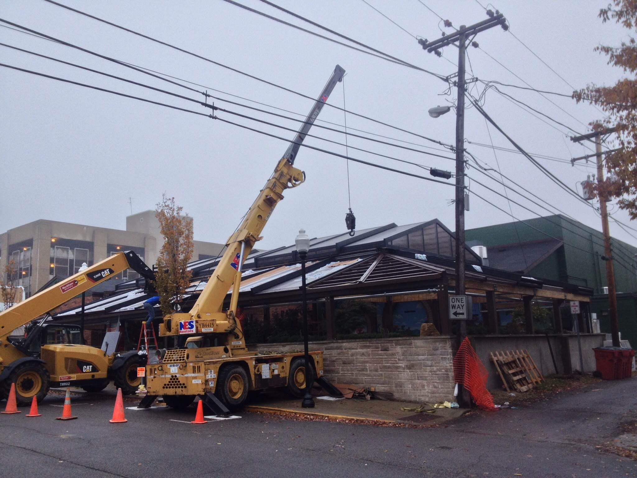 Installation of Kilroys year round patio structure