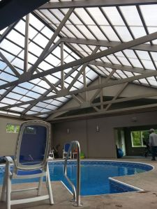 Krejci inside the residential pool house with retractable roof for year round swimming