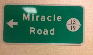 Zach-Miracle-111-Sign-at-HealthSouth-pointing-to-Zach's-room