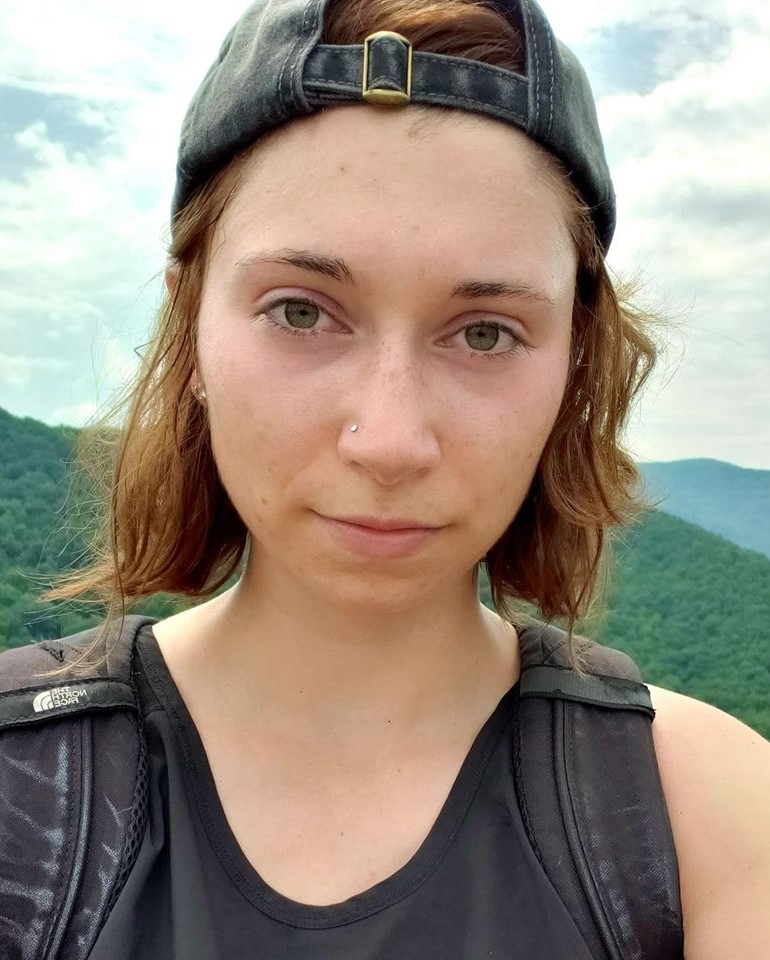 Kara Grosso selfie with mountains in the background.