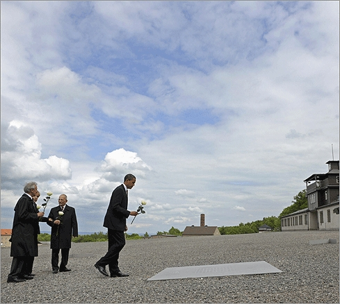 President Barack Obama, following his visits to Saudi Arabia and Egypt, traveled on June 5 to Germany, where he visited Buchenwald, the former Nazi concentration camp where more than 56,000 prisoners died. From left: Buchenwald concentration camp survivor Elie Wiesel, German Chancellor Angela Merkel, International Buchenwald Committee President Bertrand Herz, and Obama laid roses in remembrance of Holocaust victims. Obama's great-uncle, Charles Payne, was among the first US soldiers to arrive at the nearby subcamp of Ohrdruf in 1945.
