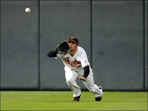 Nick Markakis dove to catch a short fly ball off the bat of Mark Loretta.