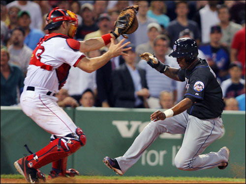 Jose Reyes was airborne, but Jason Varitek had the ball, as Reyes was thrown out by Manny Ramirez trying to score in the fifth inning.
