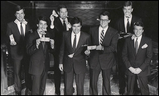 Despite the pressures at Bain Capital, Mitt Romney kept the atmosphere loose. One year, after posing for a photo for a firm brochure, the partners did another take, the second time holding $10 and $20 bills. From left, Fraser Bullock, Eric A. Kriss, Joshua Bekenstein, Mitt Romney, Coleman Andrews, Geoffrey S. Rehnert, and Robert F. White.