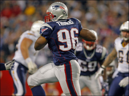 Patriots linebacker Adalius Thomas picked off a pass and headed toward the endzone in the second quarter.
