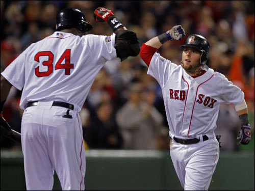 David Ortiz (left) and Dustin Pedroia (right) celebrated Pedroia's first inning homer.