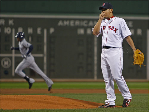 Red Sox pitcher Dice-K Matsuzaka (right) reacted after allowing a first inning home run to B.J. Upton (left).