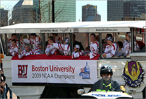Terrier teammates rode in duck boats for a parade. They drove past thousands of fans along the route from Kenmore Square to Marsh Plaza on the BU campus.