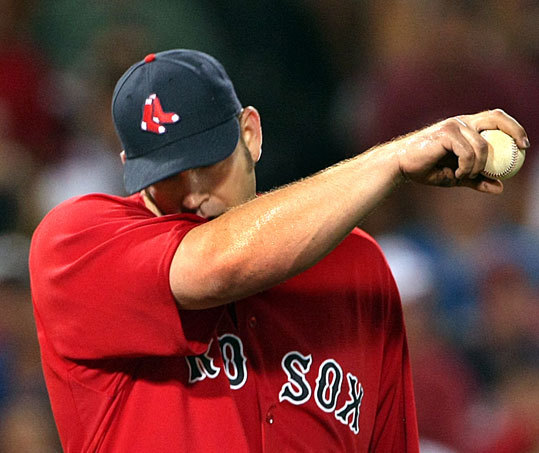 Brad Penny wiped sweat from his face after the third run scored for the Yankees.