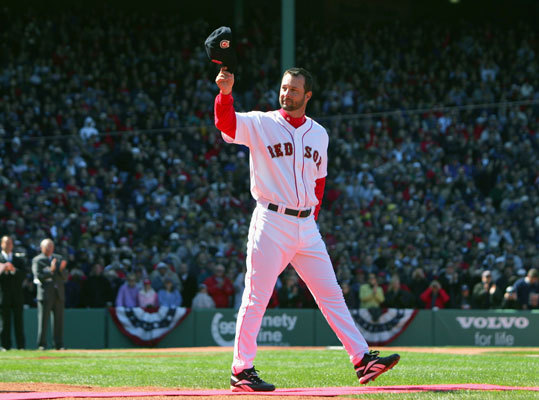 Wakefield waves to the fans at Fenway Park during a pregame ceremony celebrating the Red Sox win in the 2004 World Series. The ceremony was held prior to the 2005 season opener against the New York Yankees in Boston.