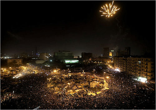 Egyptian antigovernment protesters celebrated under fireworks at Cairo's Tahrir Square on Friday.