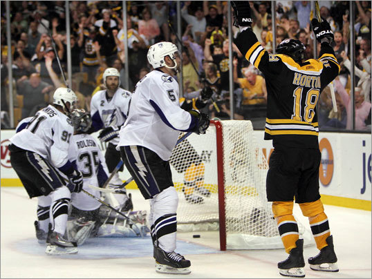 Bruins right winger Nathan Horton (right) scored with 7:33 left in the third period as the Bruins defeated the Tampa Bay Lightning 1-0 in Game 7 of the Eastern Conference finals Friday night at TD Garden.