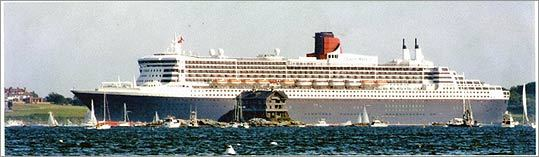 Queen Mary 2 dwarfed Clingstone as it sailed by years ago. The photo hangs above a doorway inside the house.