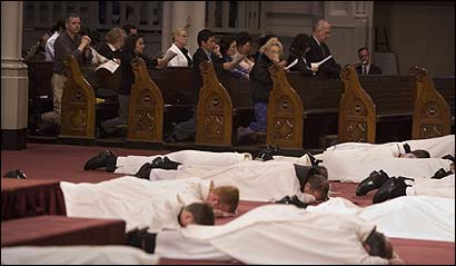 Priests prostrated themselves on the altar of the Cathedral of the Holy Cross last night, as a cantor and choir sang a litany of repentance.