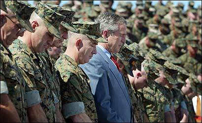 President Bush joins marines in prayer at Camp Lejeune, N.C., on April 3, 2003. Accordiing to a Pew Charitable Trusts poll that month, 87 percent of white American evangelicals supported the president's decision to invade Iraq.
