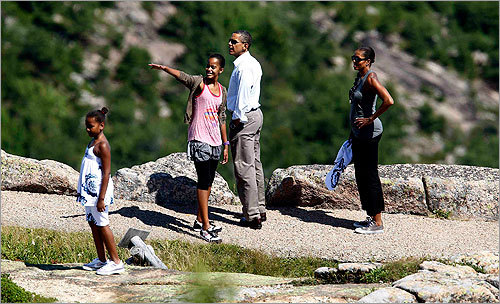 The Obamas walked along a trail with their daughters Sasha, left, and Malia on Cadillac Mountain.