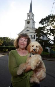 The Rev. Rachel Bickford, with 16-week-old cockapoo Indy, is starting a ''woof 'n' worship'' service at the Pilgrim Congregational Church in Weymouth.