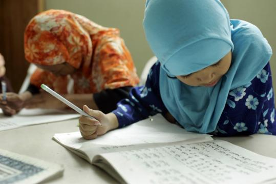 In a mosque fashioned from a condo unit in Santa Ana, Calif., Cham girls practiced writing the Arabic alphabet.