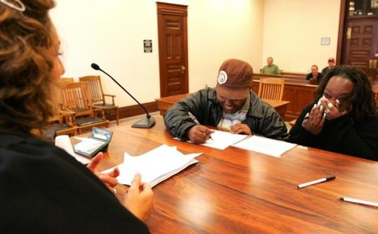 Veronica Spann (left) and Kentaindra Scarver were emotional as their marriage waiver was approved in Iowa on April 27.